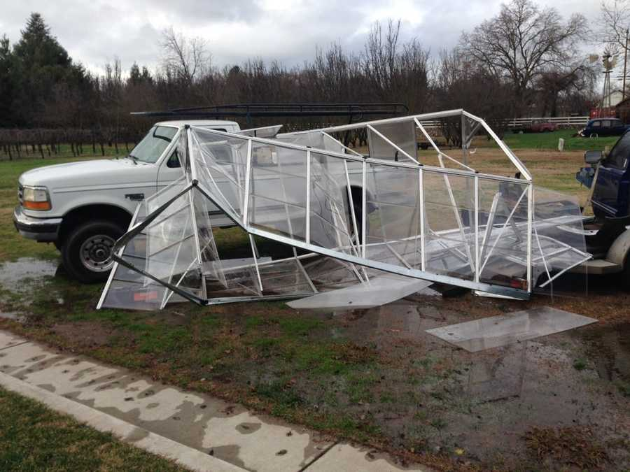 Homeowners in Oakdale said strong wind gusts carried a greenhouse over the top of their home, which was located 50 feet away. (Jan. 19, 2016)