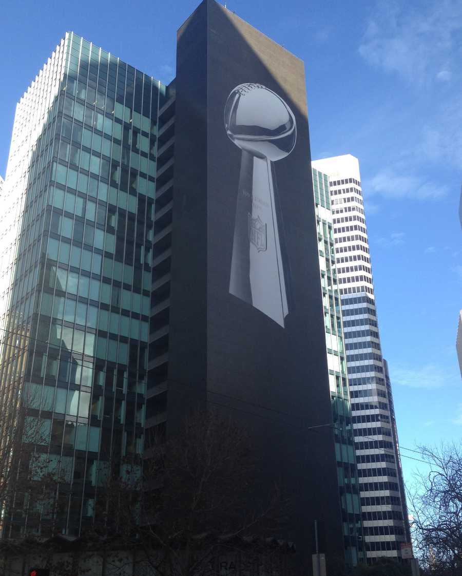 Hey look, it's a larger-than-life Lombardi Trophy on the side of a building near the entrance of Super Bowl City.