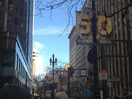Sidewalks, street lights and buildings along Market Street in San Francisco are all decked out for Super Bowl 50.