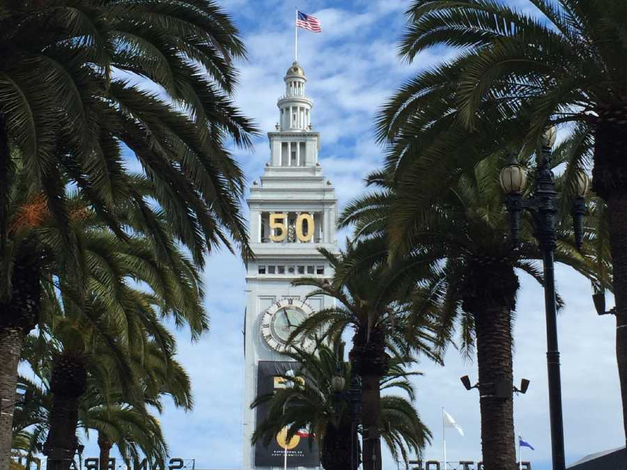 The top of San Francisco's Ferry Building is decorated with Super Bowl 50 signage.