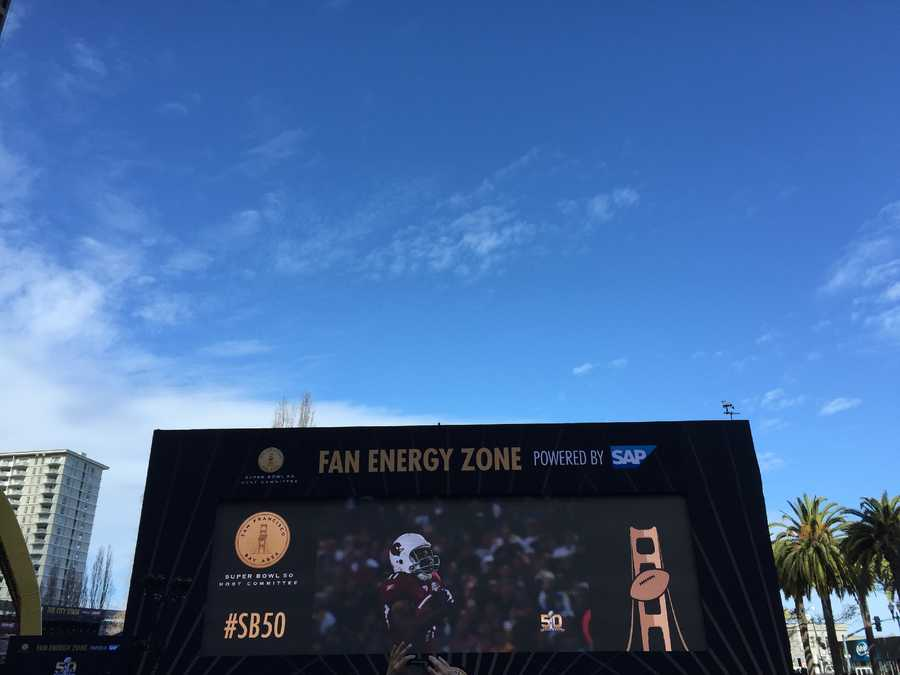 A giant monitor showing Super Bowl highlights has been put up at the Fan Energy Zone at Super Bowl City.