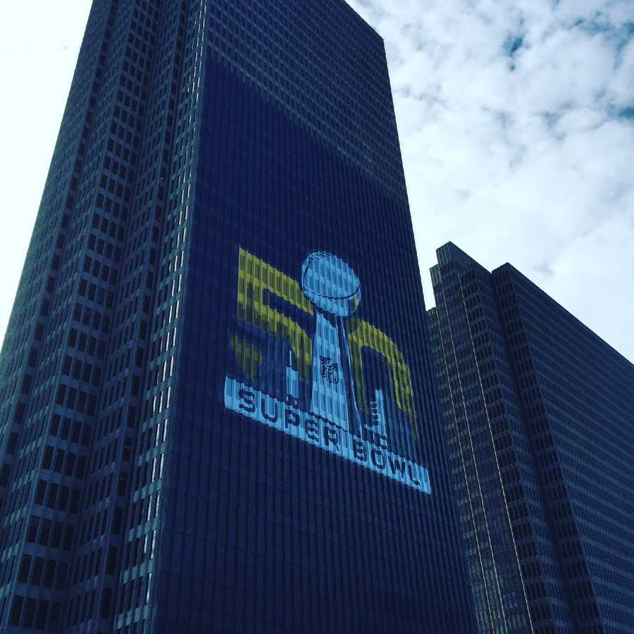 A Super Bowl 50 sign hangs near a building along the Embarcadero in San Francisco.