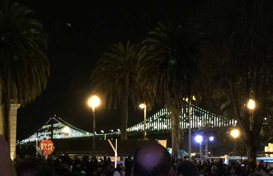 The Bay Bridge was refitted with permanent lights and re-lit Saturday as part of the festivities to kick off the opening of Super Bowl City.