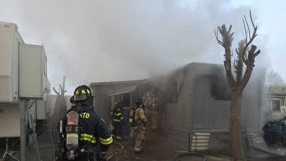Fire broke out at a mobile home Tuesday morning on South Seventh Street in Modesto, officials said.
