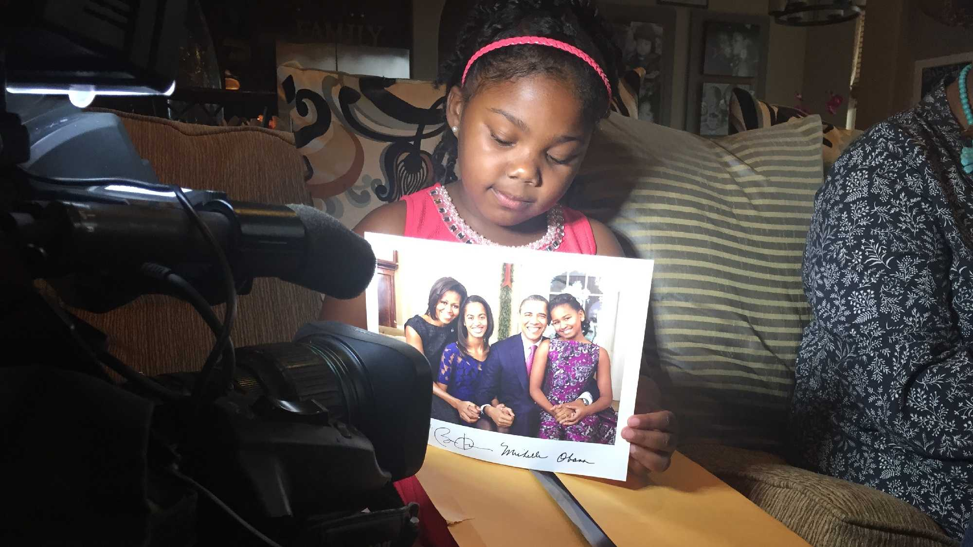 Nylah Missouri, 7, holds up an autographed photo from the First Family. She got the picture in response to a letter she wrote to President Barack Obama.