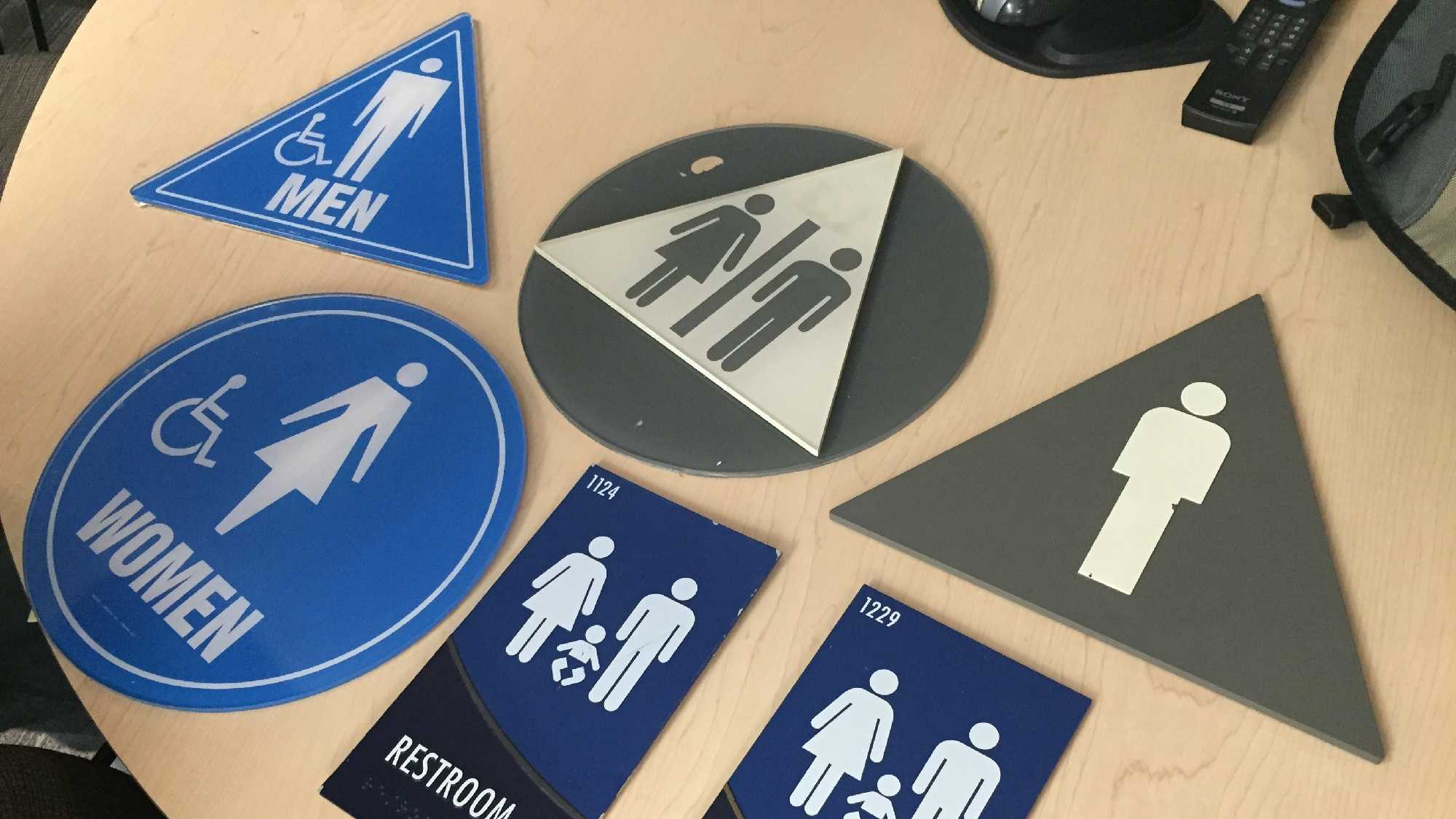 Gender-specific signs were taken down from 120 restrooms on the UC Davis campus on Thursday, Feb. 11, 2016, and replaced with gender-inclusive signs.