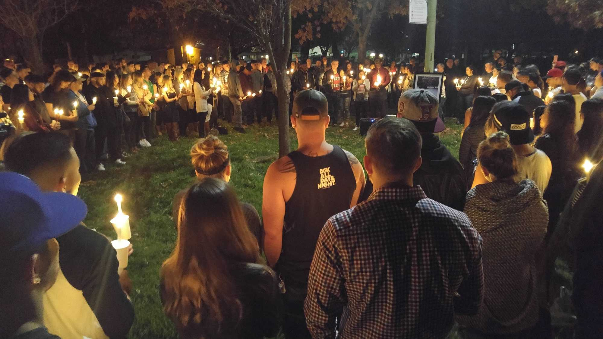 More than a hundred family members and friends gathered at Glenbrook Park in Sacramento on Friday, Feb. 12, 2016, for a vigil to remember Brett Jones. Jones was killed in a drunk driving crash the day before.