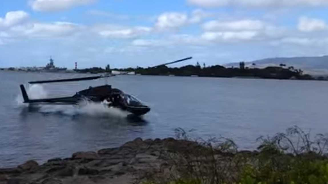 This screen grab of a YouTube video shows a civilian helicopter crashing into Pearl Harbor on Thursday, Feb. 18, 2016. Five people were injured in the crash.