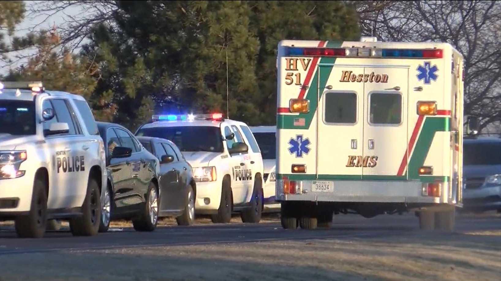Ambulance drives away from shooting scene in Hesston, Kansas, on Thrusday, Feb. 25, 2016.