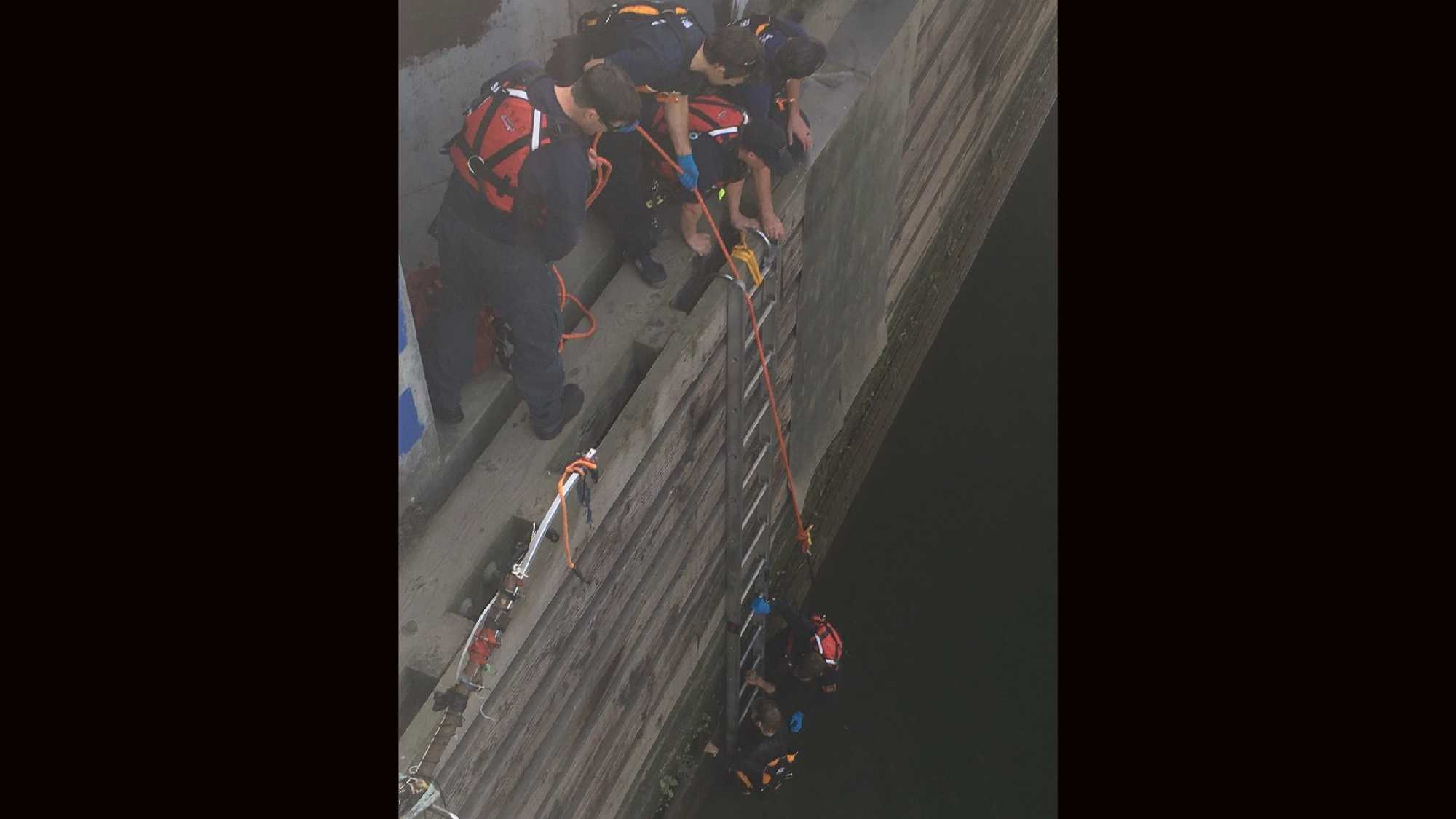 Fire crews save a homeless woman who fell 20 feet into the water in West Sacramento.