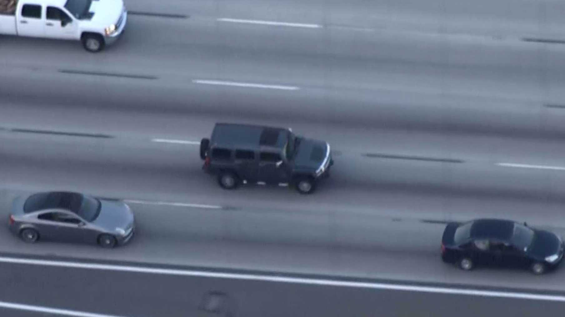 Aerial photo from KNBC helicopter shows a gray Hummer driving away from California Highway Patrol officers on Monday, Feb. 29, 2016, in Orange County.