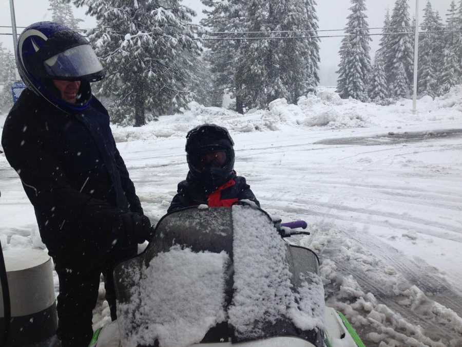 Best way to travel Sunday in the Sierra is by snowmobile, according to this father and son.