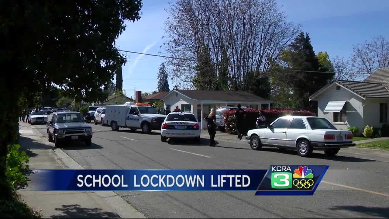 A lockdown at Oakdale and East Stanislaus high schools was lifted Tuesday after a wanted felon was taken into custody near the school following a three-hour standoff, police said.