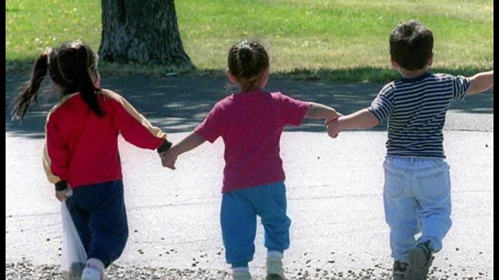 File photo: Children walking in a park.