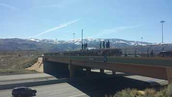 People line up on an overpass on Interstate 80 in Reno, Nev. on Wednesday, March 16, 2016, to watch the procession of fallen California Highway Patrol Officer Nathan Taylor.