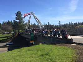 Residents lined up on the Dry Creek Road Interstate 80 overpass in Placer County on Wednesday, March 16, 2016, to honor fallen California Highway Patrol Officer Nathan Taylor. His body was moved from Reno, Nev. to Roseville, Calif.