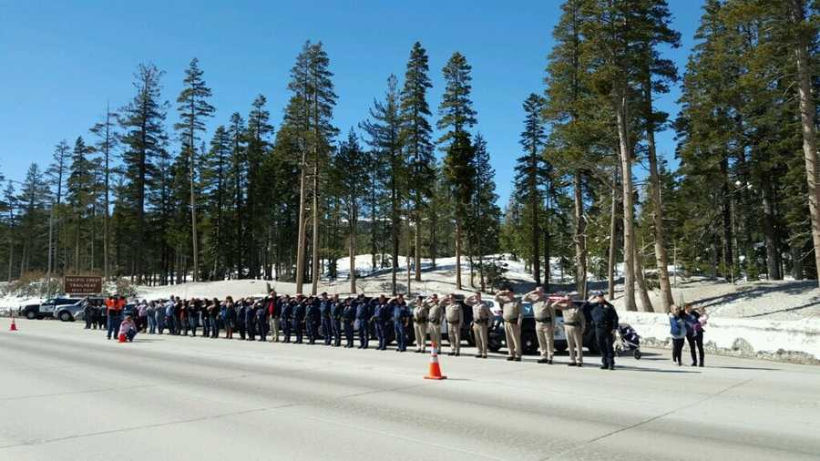 Truckee police officers line up along Interstate 80 at Castle Peak on Wednesday, March 16, 2016, to honor fallen California Highway Patrol Officer Nathan Taylor.