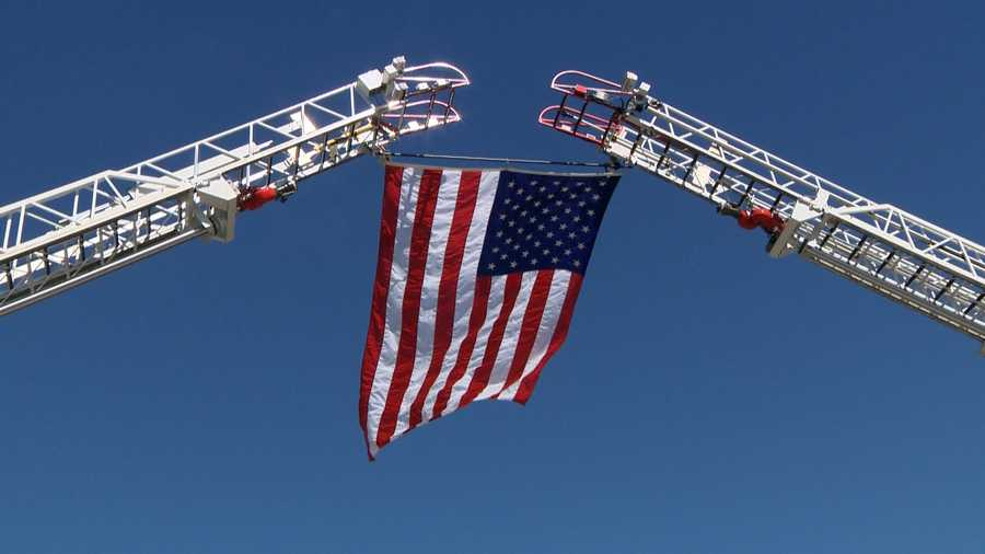 Fire trucks raise the American Flag over the Dry Creek Road Interstate 80 overpass in Placer County on Wednesday, March 16, 2016, to honor fallen California Highway Patrol Officer Nathan Taylor. His body was moved from Reno, Nev. to Roseville, Calif.
