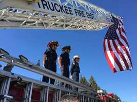Truckee firefighters line up along Interstate 80 on Wednesday, March 16, 2016, to honor fallen California Highway Patrol Officer Nathan Taylor as a memorial procession drove by the city.