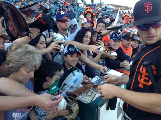 Some Giants players signed autographs before the game.