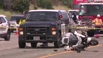 A man was taken into custody in Fairfield after hitting a California Highway Patrol motorcycle officer Thursday on Interstate 80 in Sacramento and driving away, officials said.