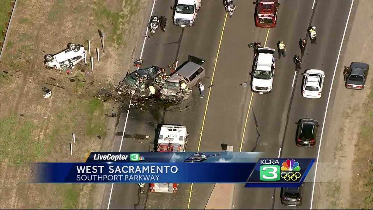 Two people are dead and two are seriously injured in a major crash that is blocking all lanes of Southport Parkway in West Sacramento, police said.