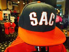 And if you want a matching hat for your jersey, check out the black and orange Sac baseball caps.