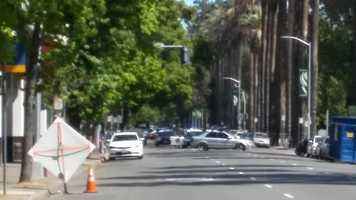 Sacramento police block off L Street, between 10th and 11th streets, because of a person barricaded inside of a car on Monday, April 18, 2016.