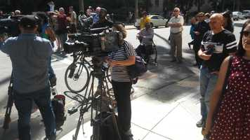 Media and citizens watch the situation unfold on L Street on Monday, April 18, 2016.