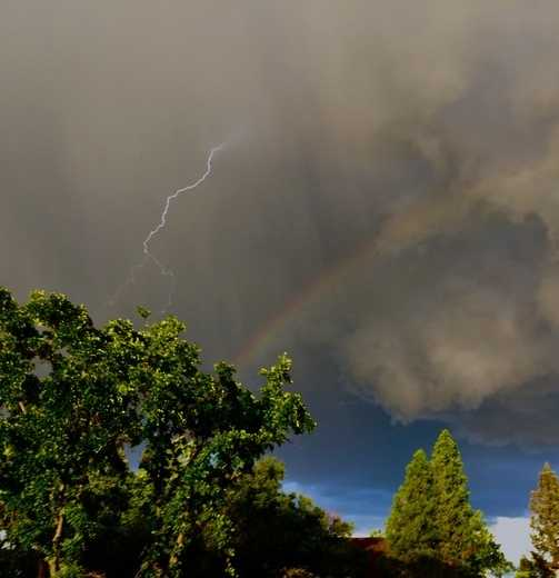 """Lightning and a rainbow -- How often do you really see these two things at the same time?"""