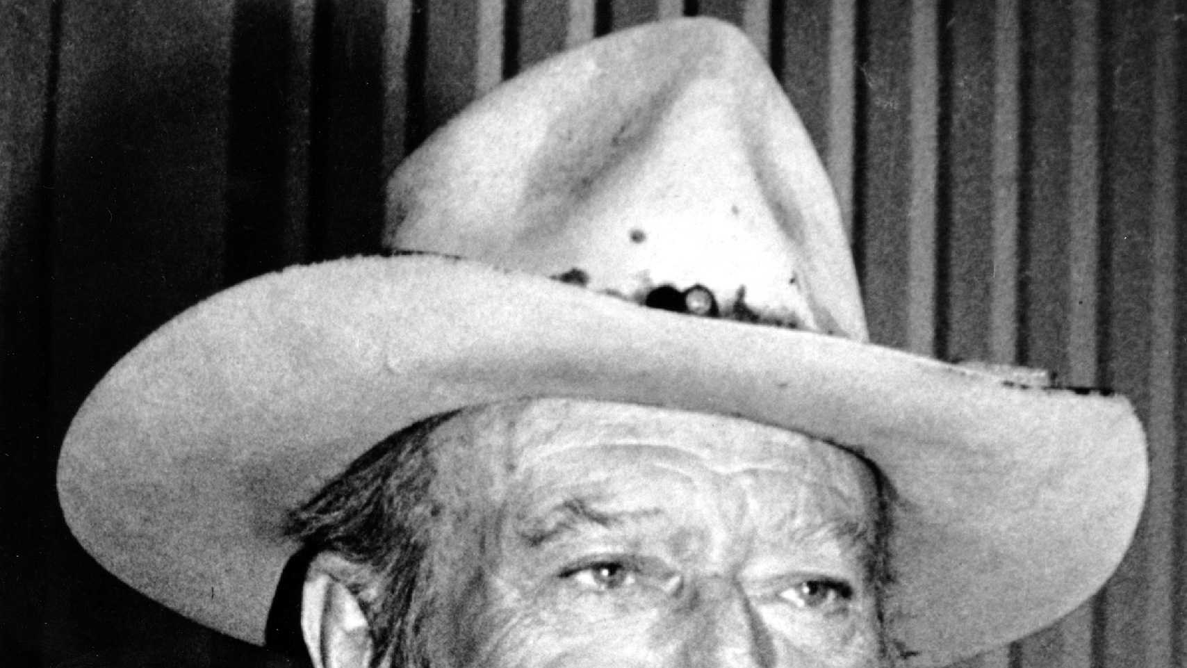 Actor-director John Wayne is photographed in an unknown location in 1978.