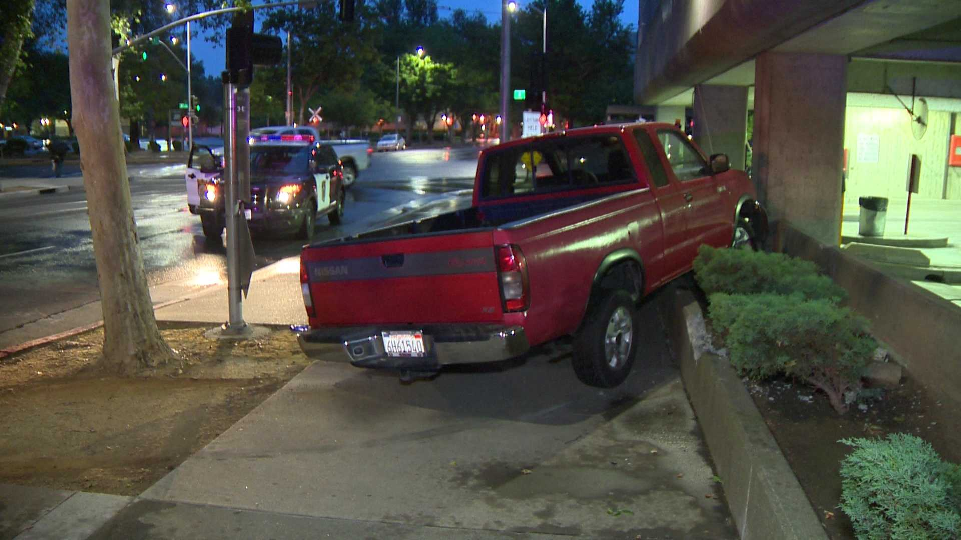 The driver of this red pickup truck crashed into a parking structure near the Sacramento  County Sheriff's Department office on Sunday, May 8, 2016.
