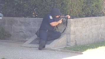 Police have set a perimeter, armed with weapons.