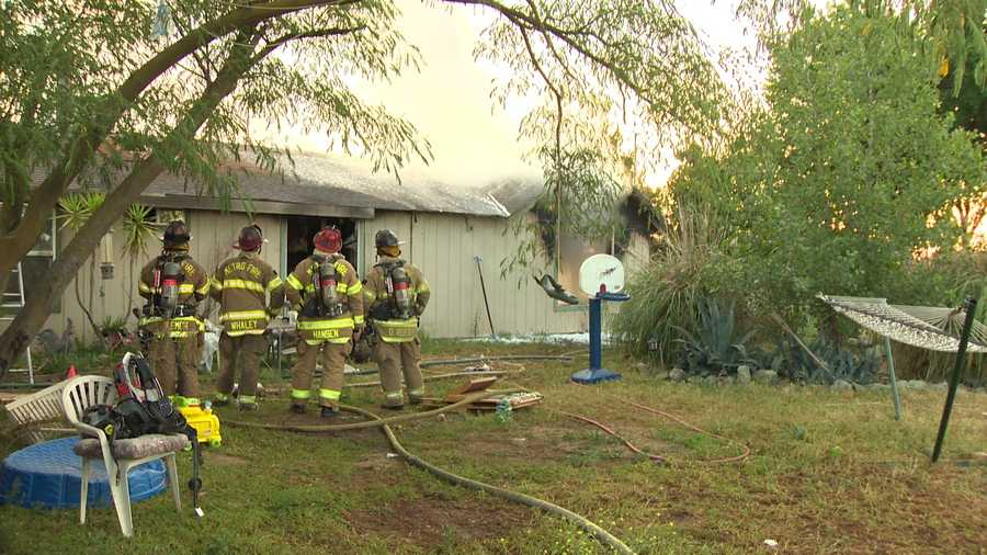 The Sacramento Metro Fire Department knocks down a fire at a south Sacramento home on Sunday, May 15, 2016.
