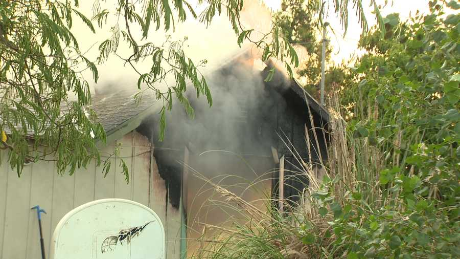 Sacramento Metro fire crews knocked down a fire at a south Sacramento home Sunday, May 15, 2016. Flames and smoke could be seen coming out of the roof of the home when firefighters arrived at the scene.