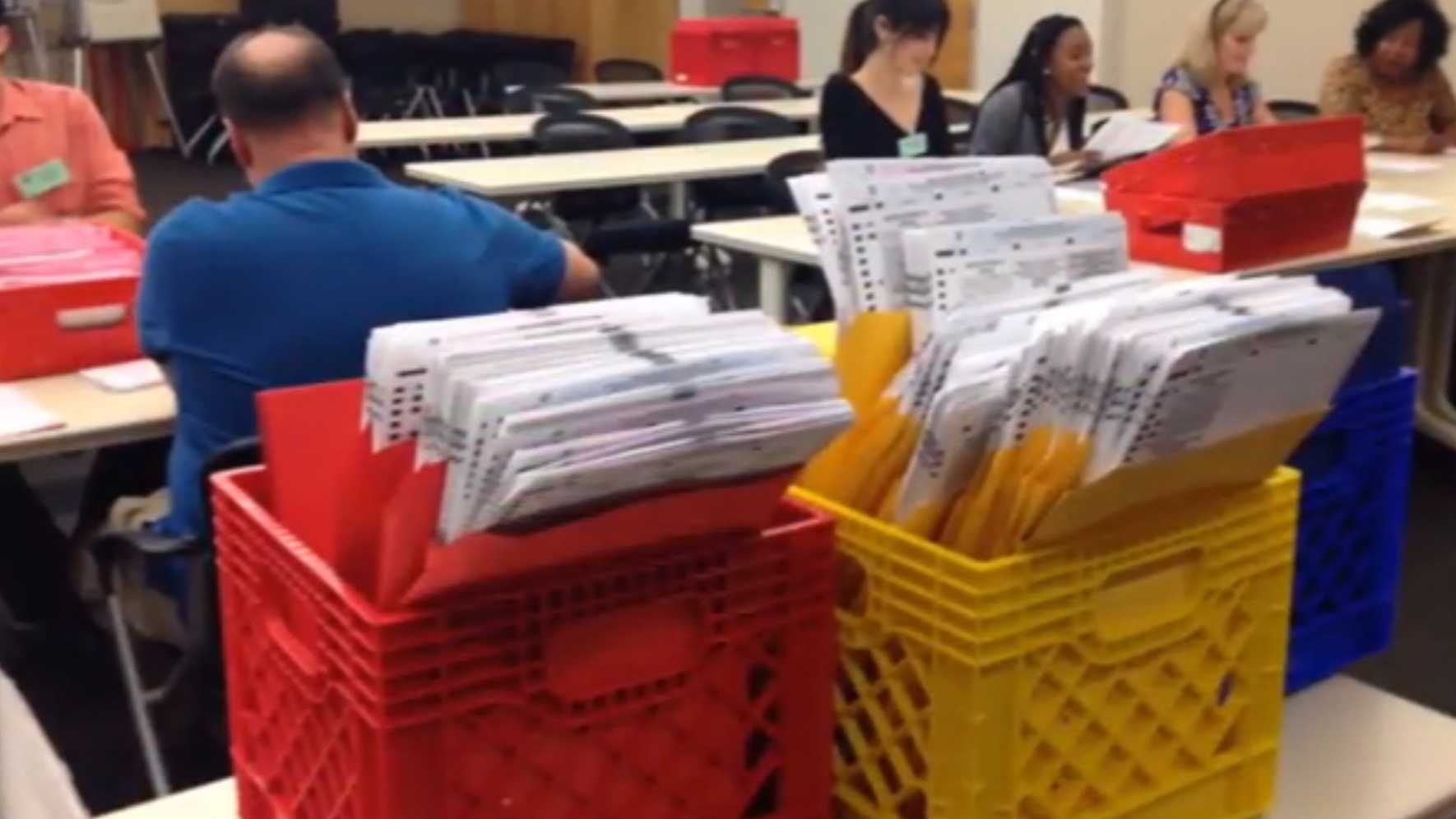 Election officials sort mail-in ballots in Sacramento County on Wednesday, May 25, 2016.