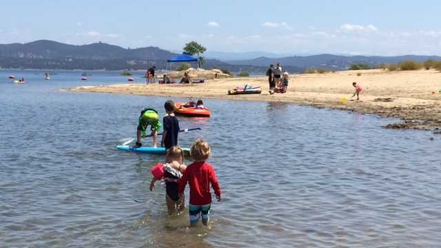 Families enjoyed the water at the beach at Folsom Lake on Friday.