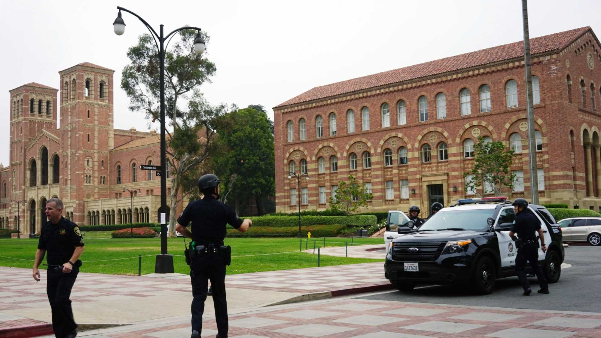 Police work at the scene of a shooting at the University of California, Los Angeles, Wednesday, June 1, 2016, in Los Angeles. (AP Photo/Christine Armario)