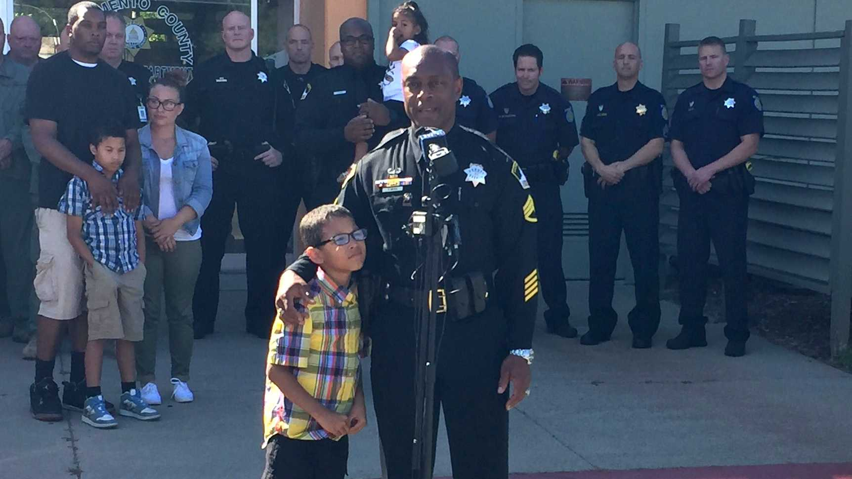 Michael Pittman Jr., 7, and Sacramento County Sheriff's Deputy Orlando Mayes reunite on Wednesday, June 9, 2016 -- six years after Michael was rescued from a 55-hour standoff.