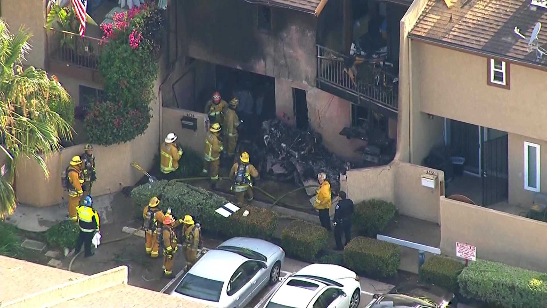 A plane crashed into the front of a town house Friday, June 10, 2016, in Hawthorne, California.