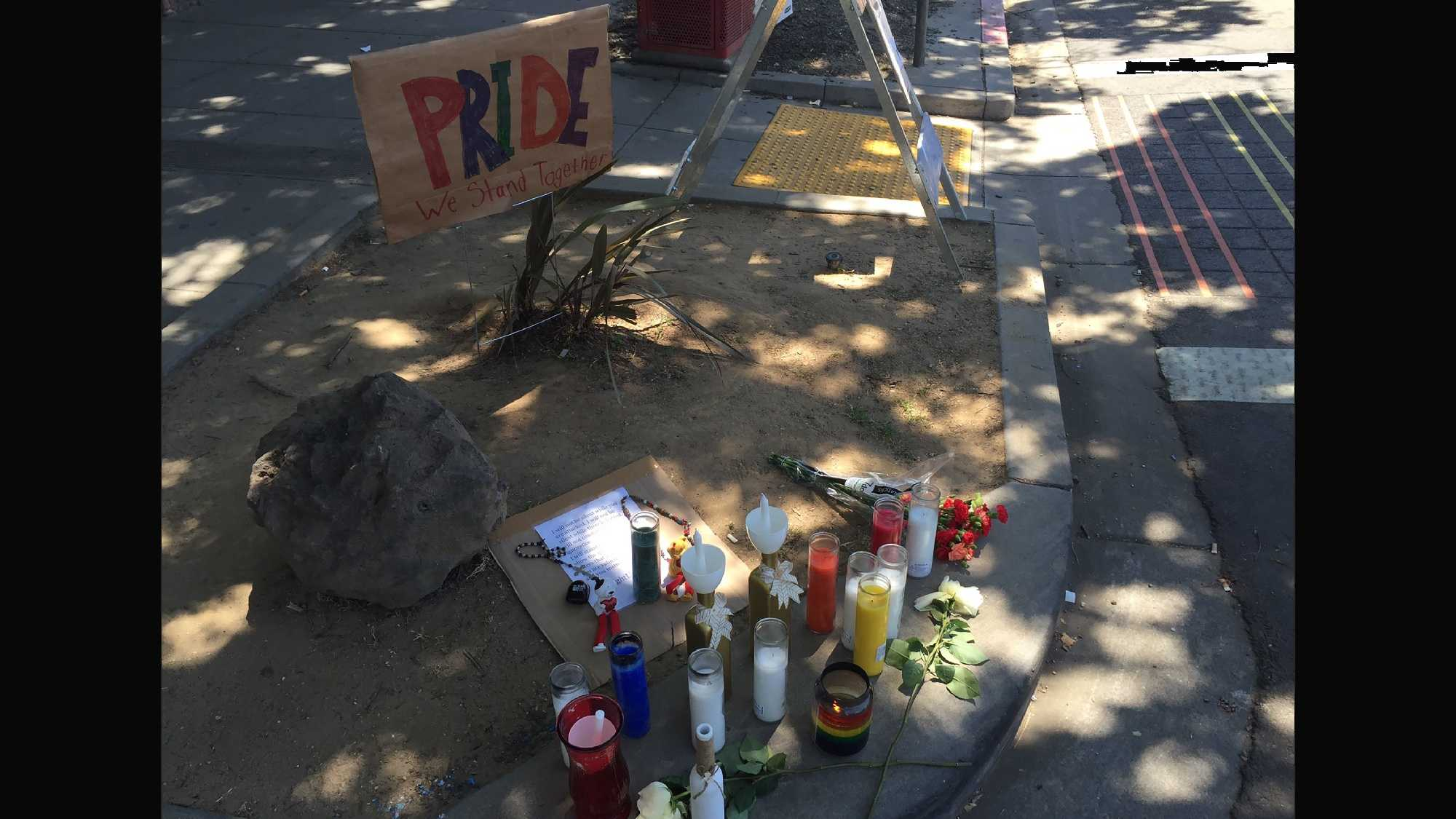 """""""Pride we stand together"""" written at the growing memorial at 20th and K in midtown Sacramento."""