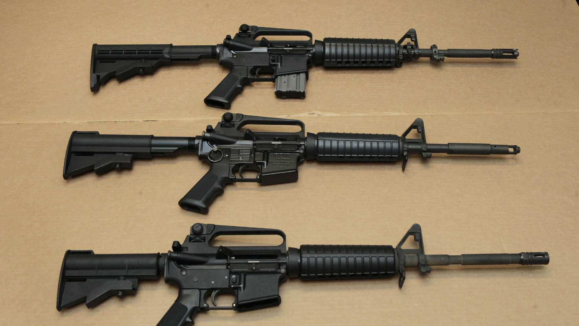 In this Aug. 15, 2012 file photo, three variations of the AR-15 assault rifle are displayed at the California Department of Justice in Sacramento, Calif. While the guns look similar, the bottom version is illegal in California because of its quick reload capabilities. Omar Mateen used an AR-15 that he purchased legally when he killed 49 people in an Orlando nightclub.