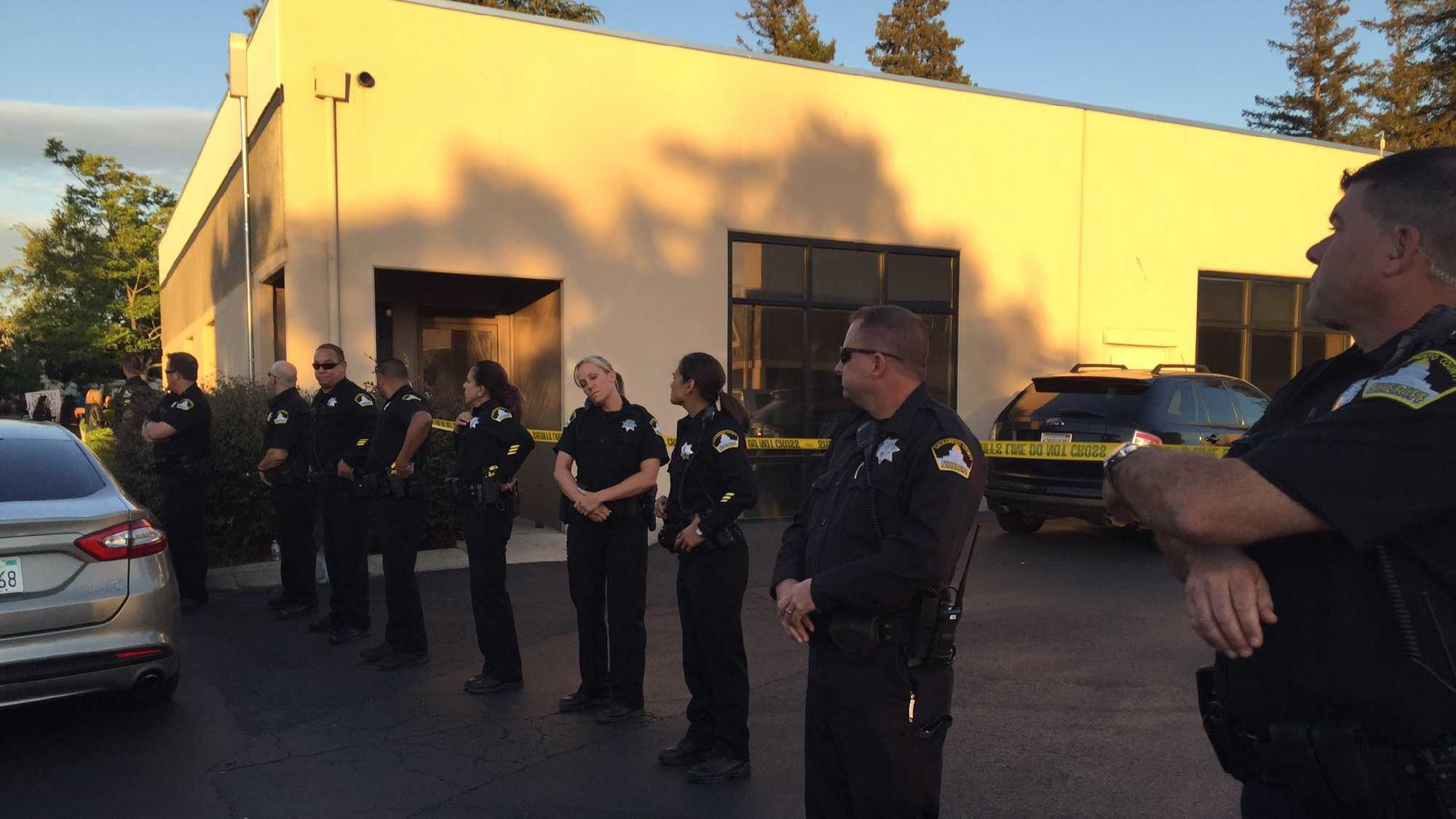 Sacramento County sheriff's deputies block protesters outside of Sacramento's Verity Baptist Church on Wednesday, June 15, 2016.