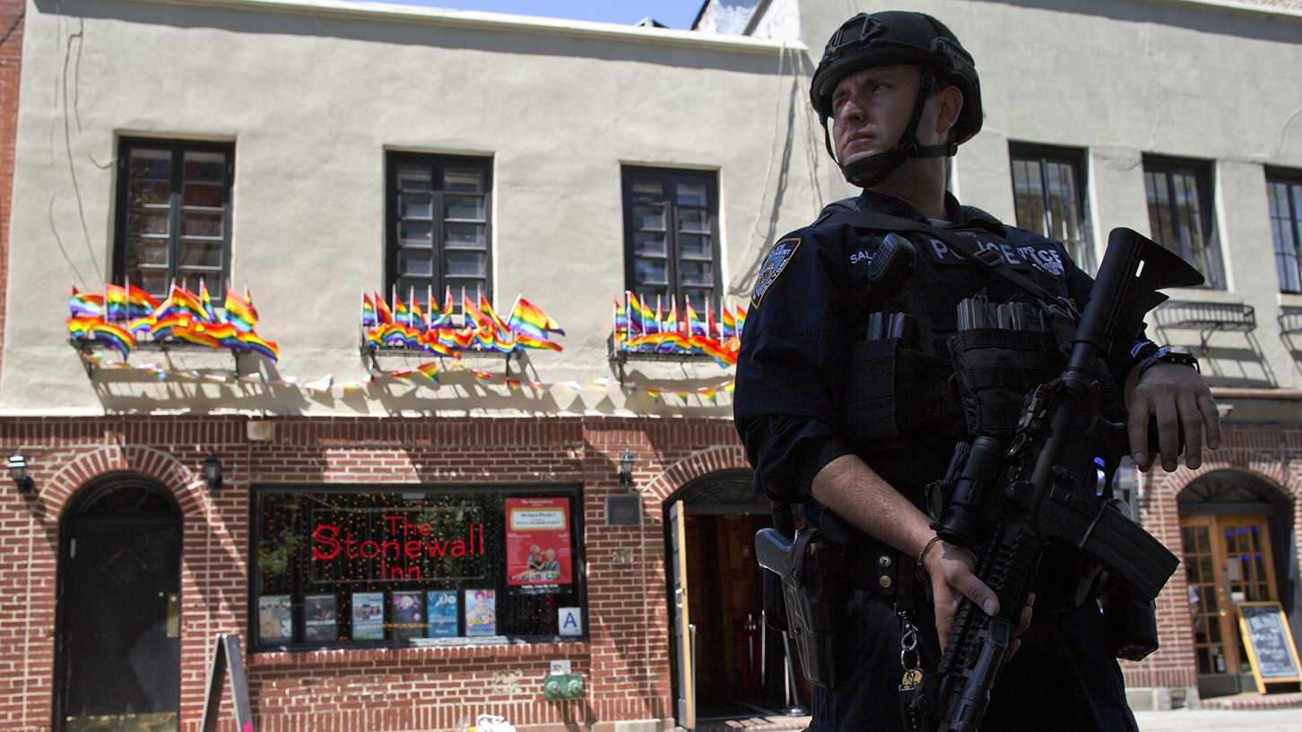 In a June 12, 2016 file photo, an armed police officer stands guard outside the Stonewall Inn, in New York.