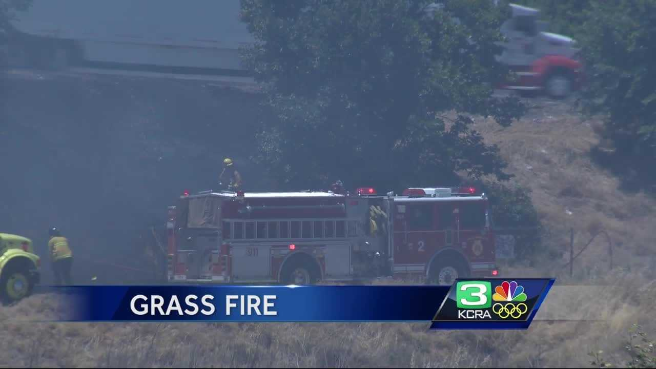 Grass fire by Interstate 5 near Richards Boulevard in Sacramento.