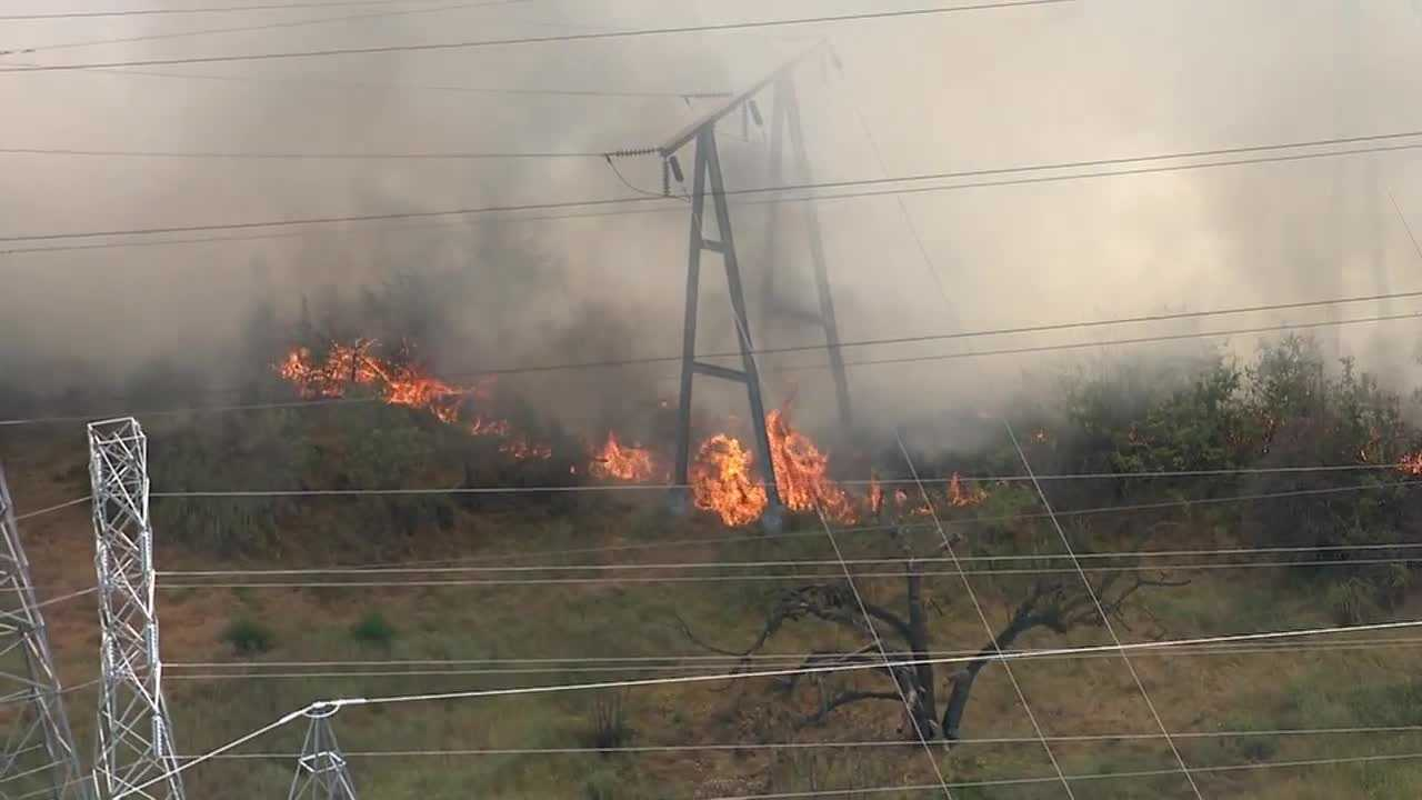 Grass fire burns along the American River Parkway near Cal Expo.