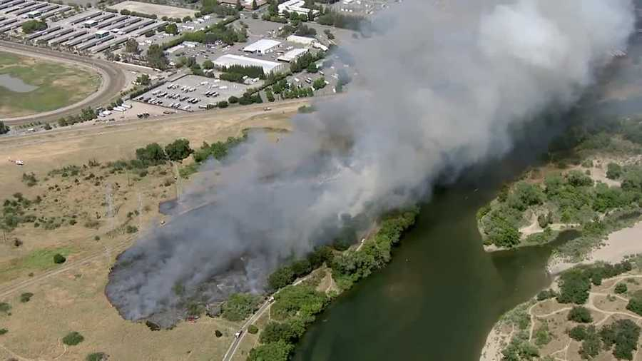 Firefighters tackled a 45-acre grass fire is burning near Cal Expo on Monday, June 20, 2016. The fire is burning along the American River Parkway. Here are some photos taken of the fire.