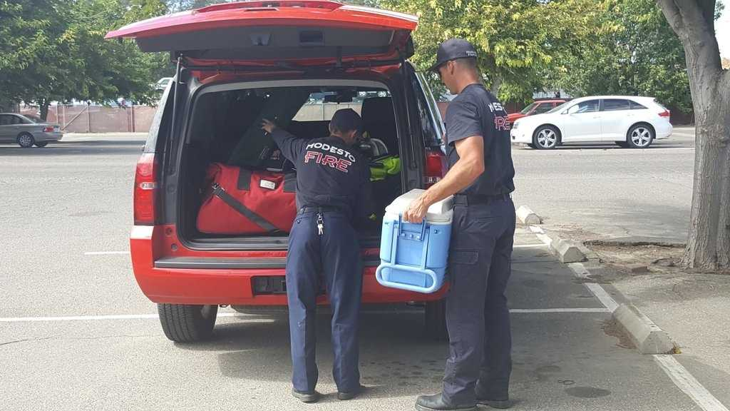 Firefighters with the Stanislaus and Tuolumne Counties strike team load up on water to take to the Border Fire.