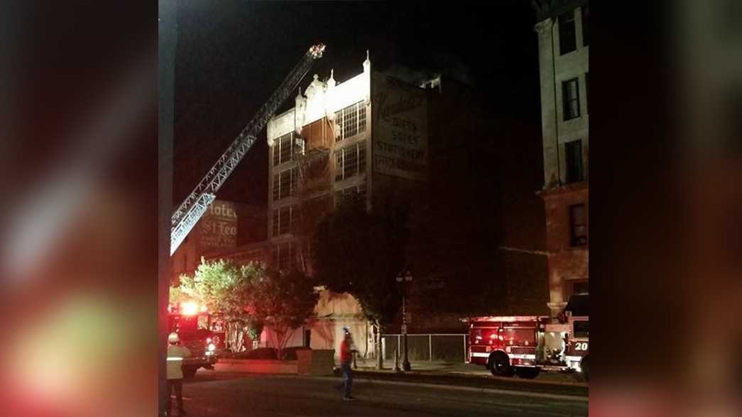 Crews fight fire at the Kendall Stationary Building in downtown Stockton on Tuesday, June 21, 2016.
