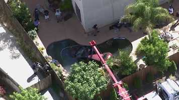 A SUV crashed into a pool at an Elk Grove home on Wednesday, June 22, 2016. Photos from LiveCopter 3 show the vehicle in the pool and it being pulled out by a fire truck crane: